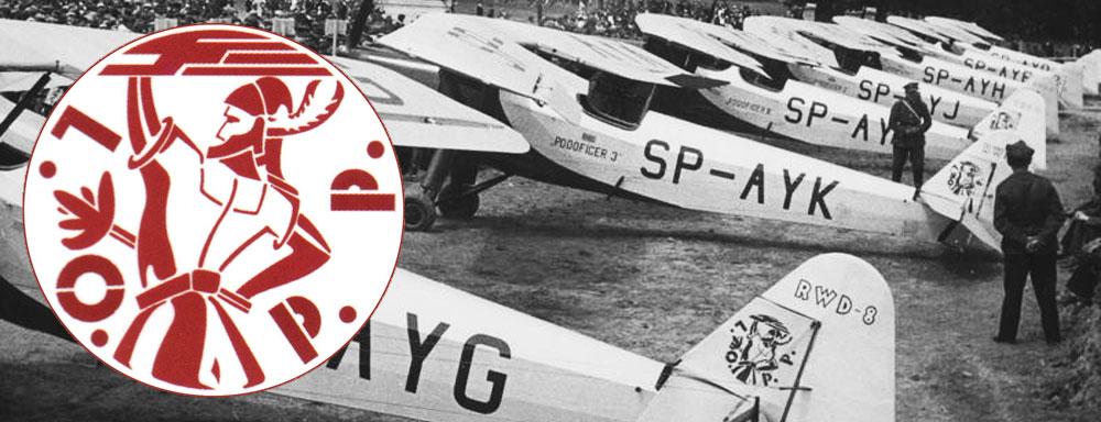 Logo L.O.P.P., oraz samoloty RWD-8 na lotnisku w Aleksandrowicach. ( Źródło: NAC )